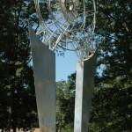 SPECTRUM: Stainless Steel & Prism; 26'H x 8'W x 6'.  Spectrum, the Sun Station is the gateway to Planet Walk a public art project on the a hike and bike trail between Baltimore and Annapolis, Maryand.  The sculptures of Planet Walk depict the essence of each planet.