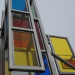 THE WINDOWS ON ARTS ALLEY: Stainless Steel & Resin; 20'H x 16'W x 6'D